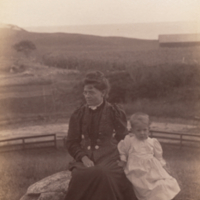 """Saddle Rock"": Shryock child and mother [?], sitting, full length, informal portrait."
