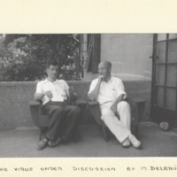 M. Delbruck and W. M. Stanley, sitting outside in conversation.