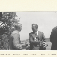 C. L. Huskins and F. Schrader standing outside in conversation.