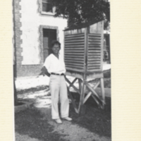 Barbara McClintock standing outside, building in background.