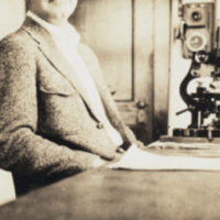 Chambers, seated at desk in laboratory, Woods Hole.