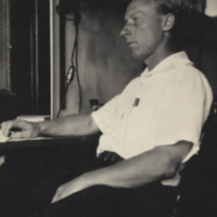 Sam Pond seated at desk.