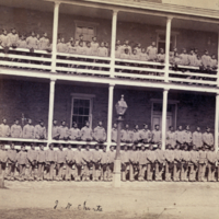Indian boys (from 16 different tribes) at the Indian Training School, April 20th 1880. (The ranks on the ground and lower porch show the same Sioux boys who appear in [image 3b]).
