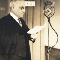 William Ezra Lingelbach, profile, 3/4 length, informal, standing in front of radio microphone.