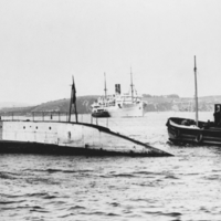 Nautilus being towed into Portsmouth, England.