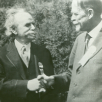 Franz Boas and Thomas Hunt Morgan, shaking hands.