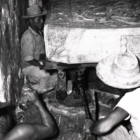Group of men working at an excavation site in Palenque, Mexico.