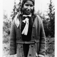 Ojibwa girl, portrait, standing outside
