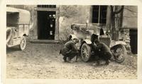 Harry Iselin and H.W. Crowhurst repairing car