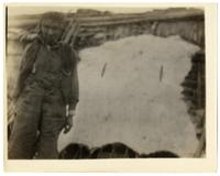 23: Man standing next to stretched hide